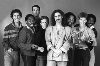 Allan Zavod on tour in 1984 with (left-right) Ray White, Scott Thunes, Robert (Bobby) Martin, Frank Zappa, Ike Willia, Chad Wackerman, & Napoleon Murphy-Brock