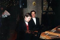 Allan Zavod with English Conductor Gavin Sutherland - playing a duet at the after-concert party - click to see an enlarged version of this image