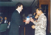 Dr. Allan Zavod presenting a gift to the Secretary General of Malaysia - click to see an enlarged version of this image